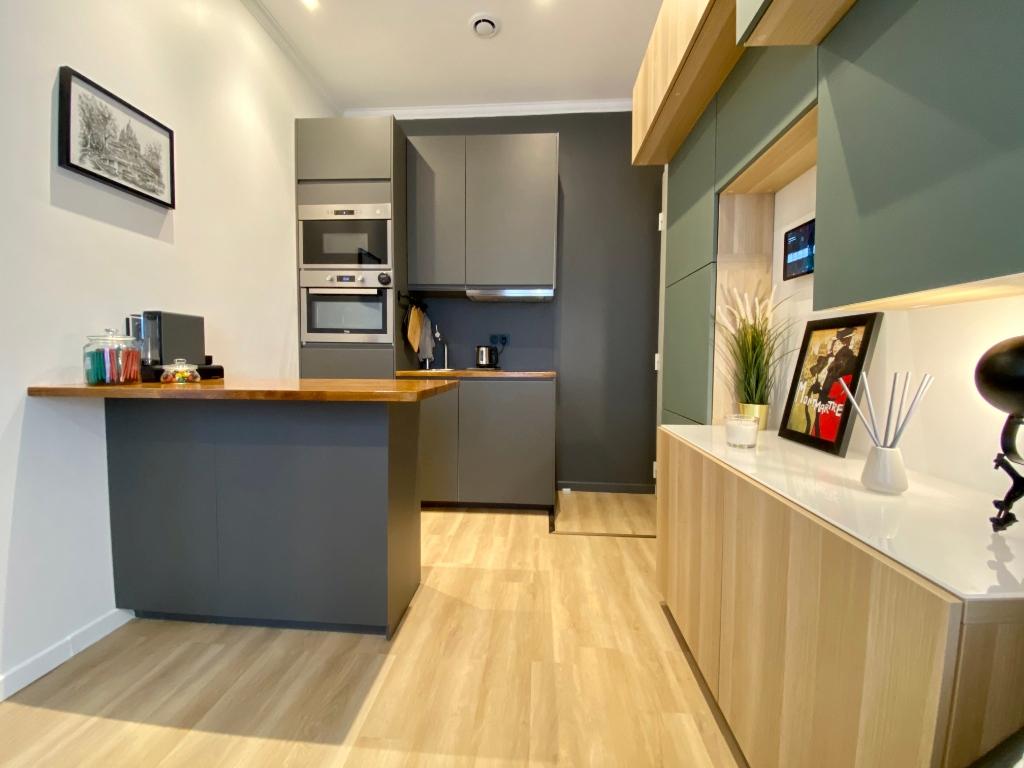 Proche sacré coeur / Rue Muller: Appartement moderne de type F2, état irréprochable, vendu meublé 2