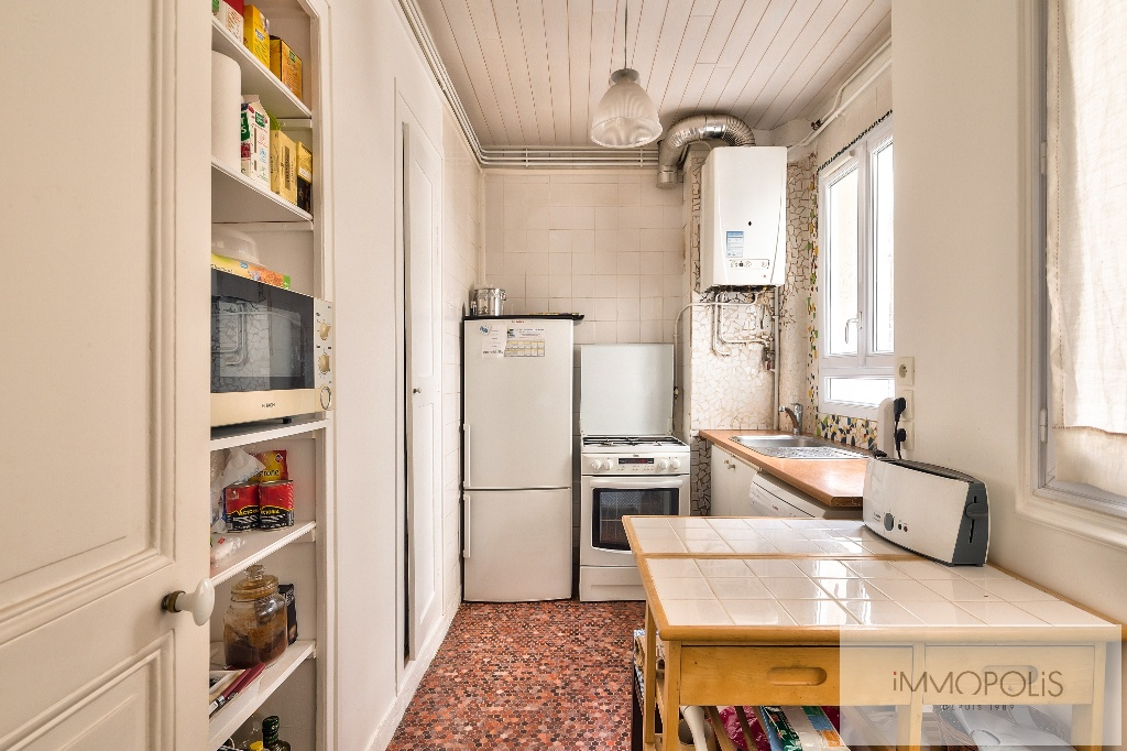 Appartement de charme rue Caulaincourt avec balcon filant et vue dégagée Sud-Est 9