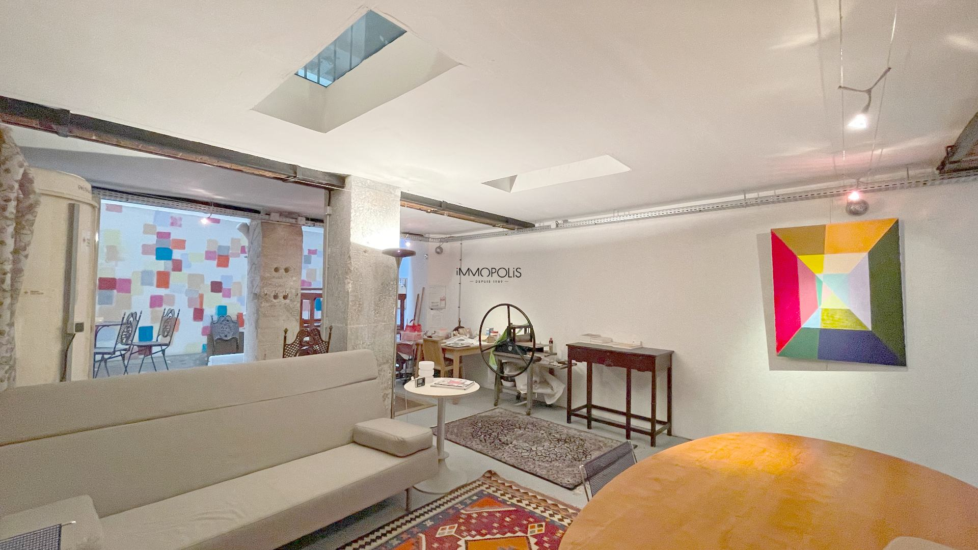 Loft / artist workshop totally atypical, in open-space on three levels with two glass windows overlooking quiet courtyard! 2